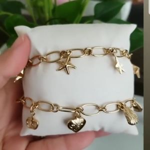 18k Gold plated clasping Bracelets.